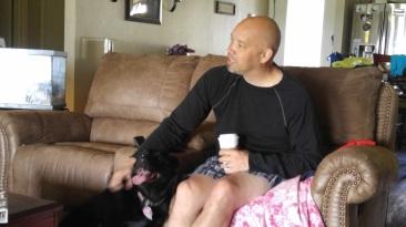 A Man, Starbucks, and his dog