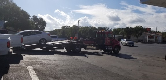 Neil's car getting towed